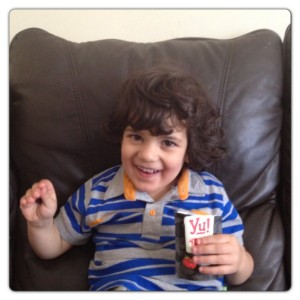Little Man Enjoying Yu! Snacks