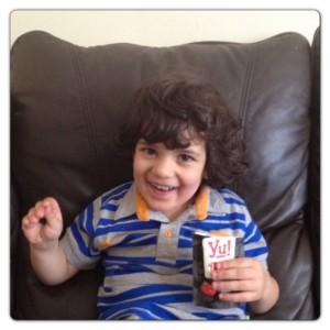 Little Man Enjoying Yu! Snacks