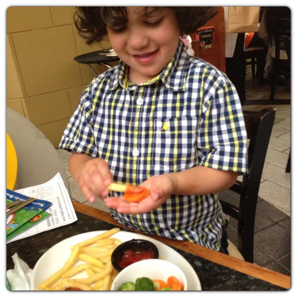 Little Man Enjoying his Meal
