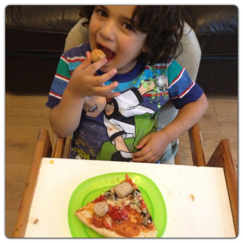 Little Man Enjoying his Pizza
