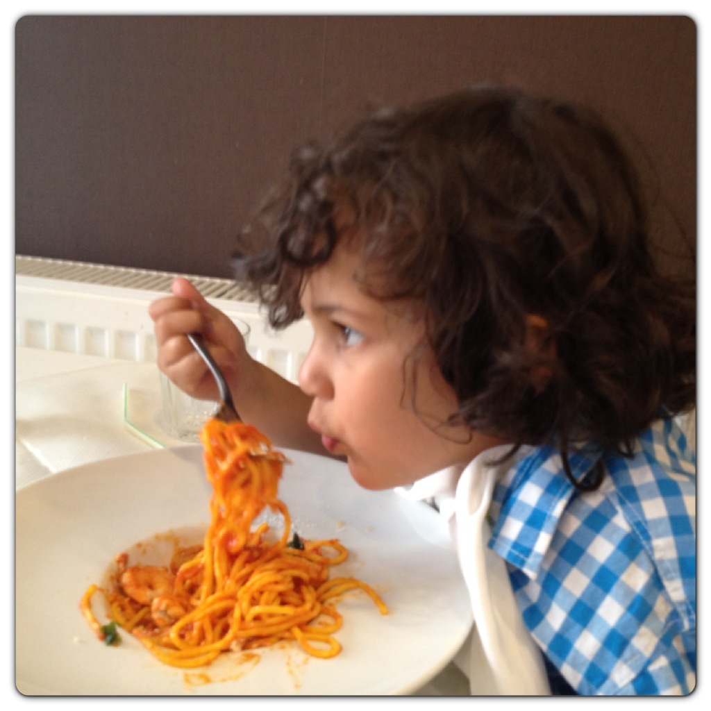 Little Man Enjoying his Pasta