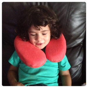 Little Man Trying Neck Pillow