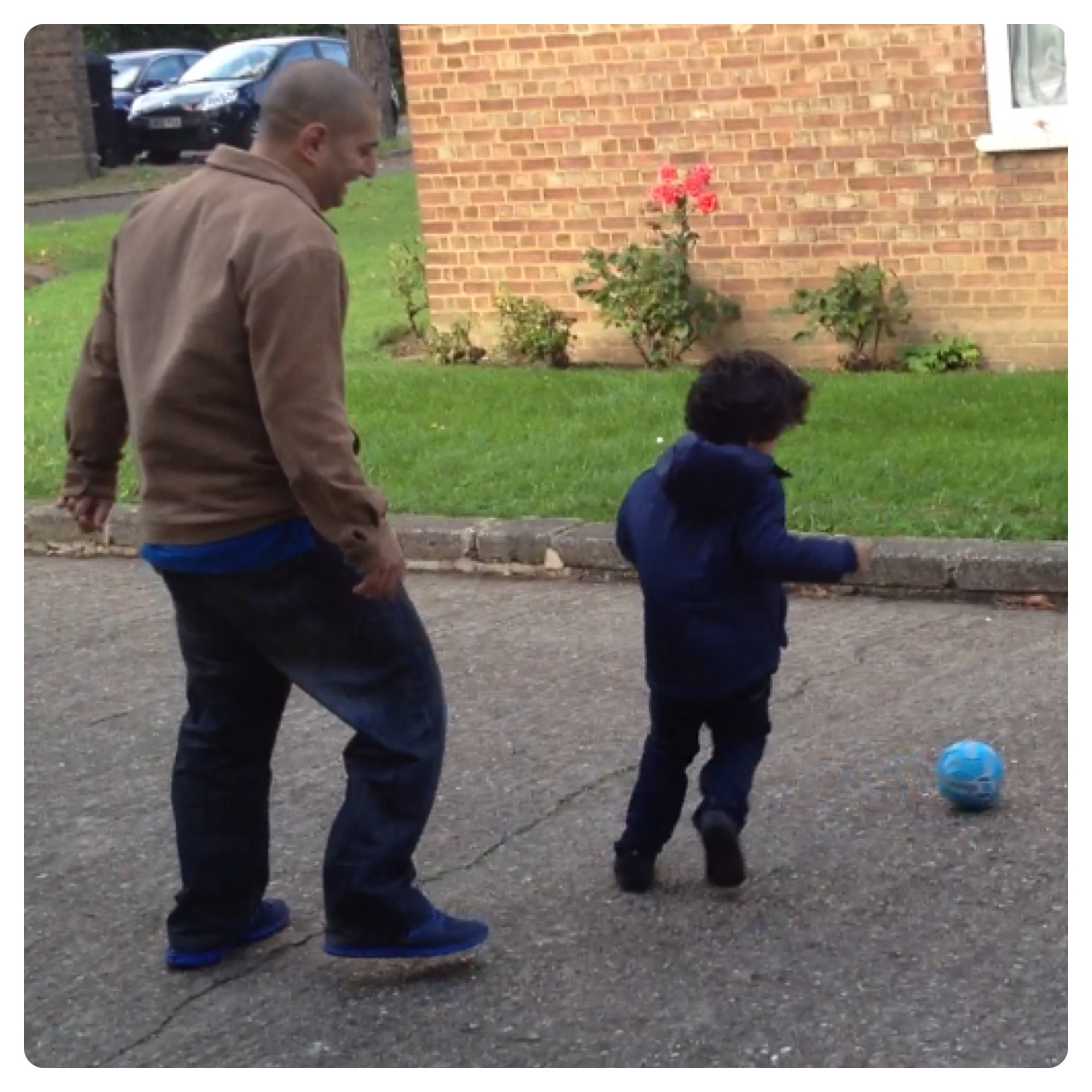 Daddy and Little Man Playing Football