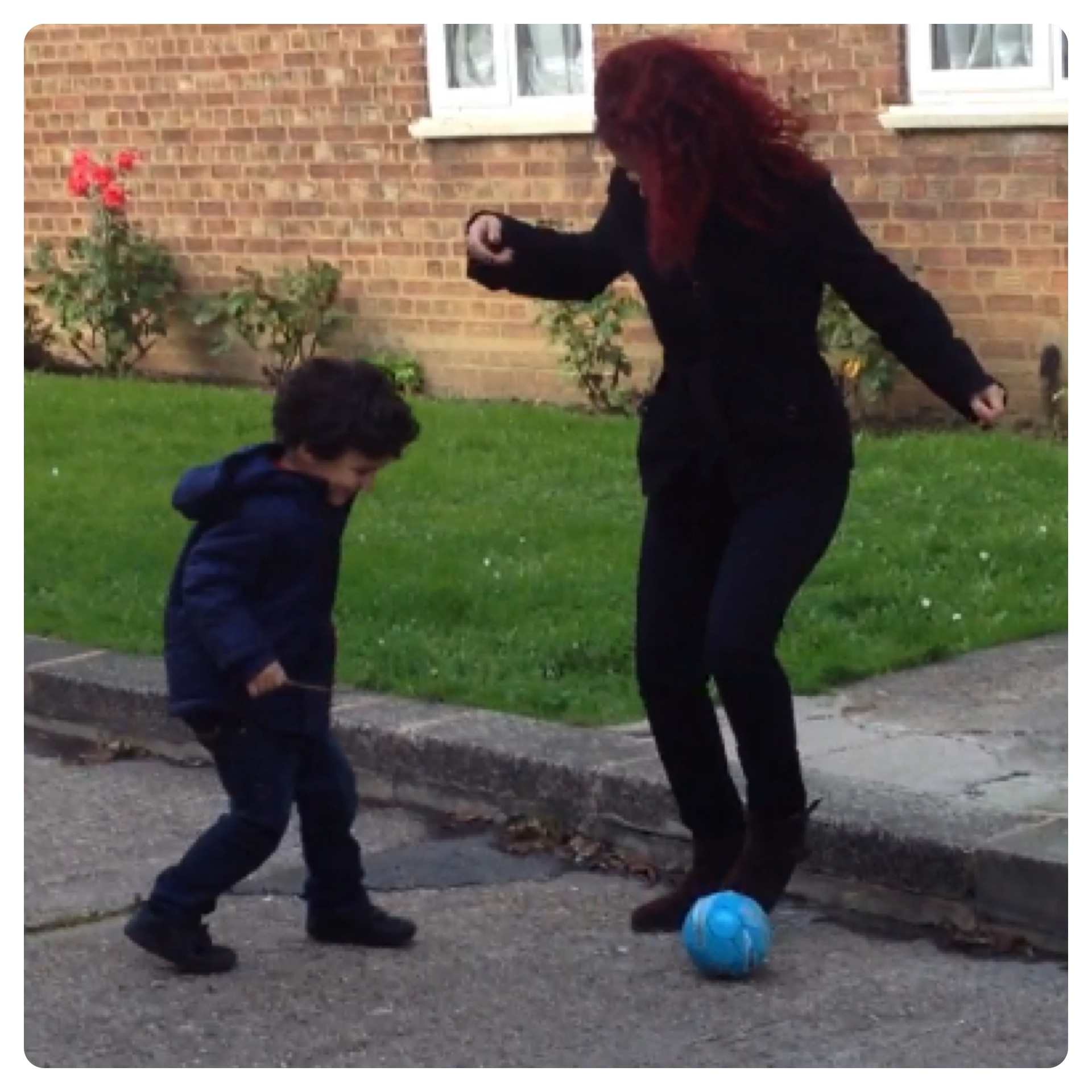 Mummy and Little Man Playing Football