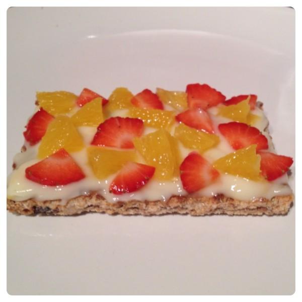 Peach Yogurt on Ryvita Fruit Crunch with Strawberry and Orange